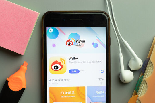 New York, USA - 1 December 2020: Weibo mobile app icon on phone screen top view, Illustrative Editorial