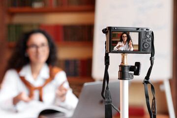 Woman recording video blog for her internet channel