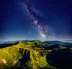 Wall Mural - Incredible view of starry sky over summits. Location place of Carpathian mountains, Ukraine.