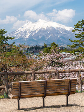 Landscape of mountain Fuji with view of city and benches at foreground