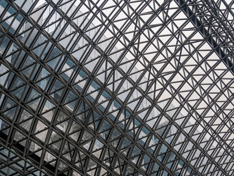 A hemispherical ceiling of glass and metal in modern building