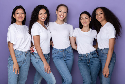 Five Joyful Diverse Ladies Posing Embracing And Smiling, Purple Background