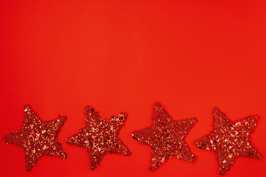 flat lay with star shaped christmas toys on red background