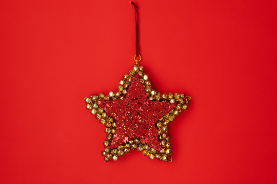 flat lay with star shaped christmas toy on red background