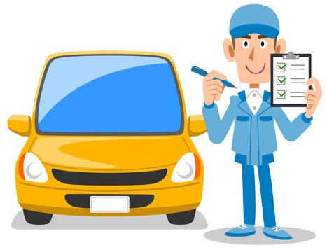 チェックリストを掲げる自動車整備工と車