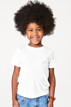 Black boy wearing white t-shirt in studio