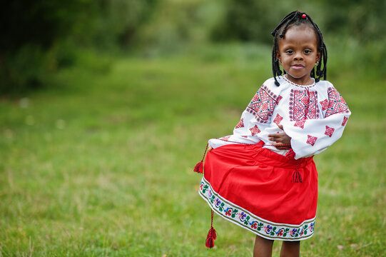 Portrait of african girl kid in traditional clothes at park.