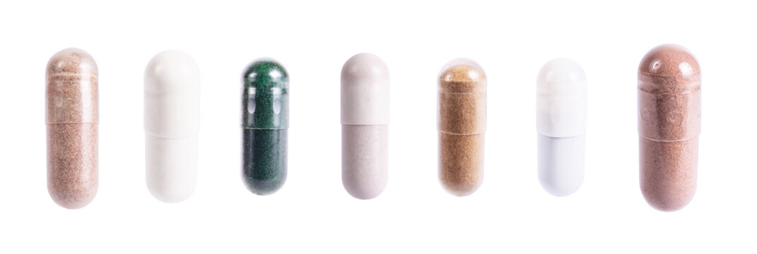 Capsules set of supplements, vitamins and medication. Nutrition pills, healthy natural medication. Vitamin C, spirulina and biotin macro photo isolated on white background.