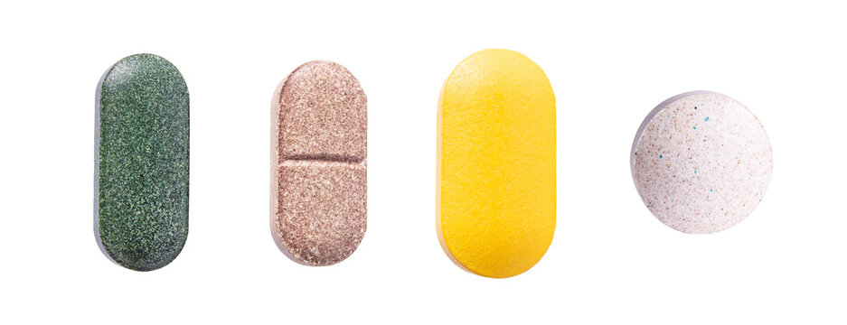 Pills set of supplements, vitamins and medication. Nutrition pills, healthy natural medication. Vitamin C, spirulina and biotin macro photo isolated on white background.