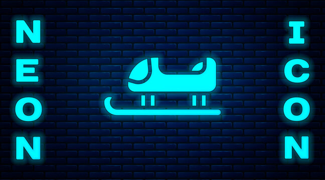Glowing neon Sled icon isolated on brick wall background. Winter mode of transport. Vector.