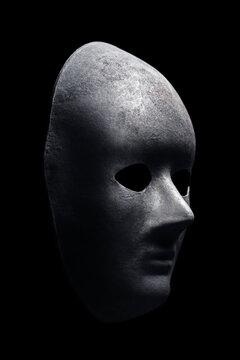 Black mask isolated on black background