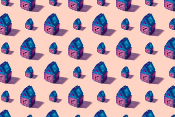 Seamless regular pattern with toy houses on a pastel background. Hard light. Minimal summer concept.