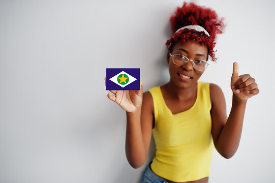 Brazilian woman with afro hair hold Mato Grosso flag isolated on white background, show thumb up. States of Brazil concept.
