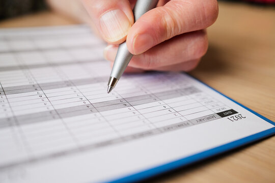Close Up Of Woman Writing Appointment In 2021 Year Planner