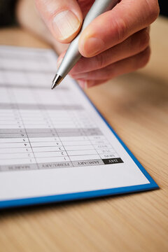 Close Up Of Woman Writing Appointment In Year Planner