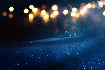 background of abstract glitter lights. Gold ,blue and black. de focused