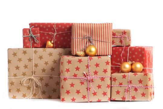 Stack of christmas gifts on golden underground with white background