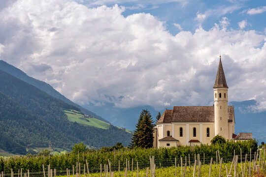 Beautiful view of Maria Lourdes church in Laas, South Tyrol, Italy under a dramatic sky