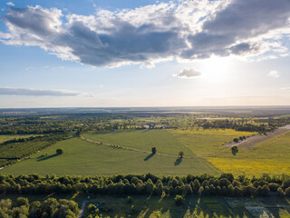Wall Mural - Panoramic aerial view from a drone above the countryside area on a sunny cloudy day.