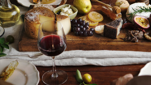 Platter of cheese with seasonal fruits and wine