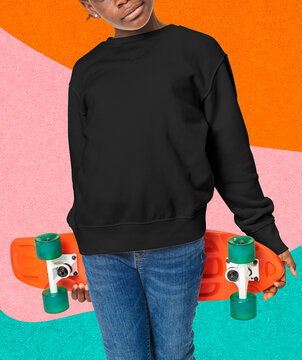 Young skateboarder in a black crewneck