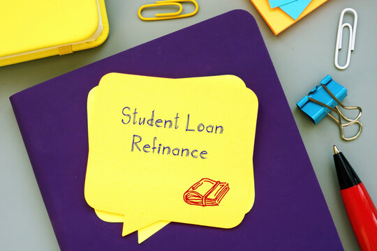 Financial concept about Student Loan Refinance with sign on the sheet.