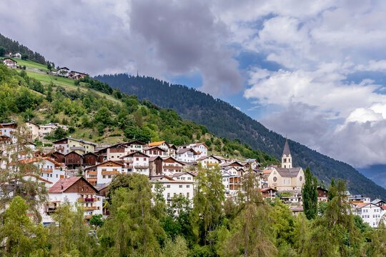 Panoramic view of the town of Stelvio, South Tyrol, Italy, with a dramatic sky in the background