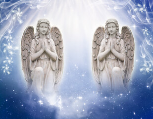 Wall Mural - two praying angels with God´s rays of Light over blue universe background