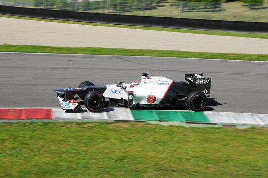 MUGELLO, ITALY - MAY 2012: Kamui Kobayashi of Sauber F1 Team races on training session in Mugello Circuit, Italy.