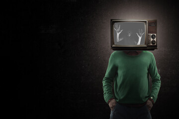 Fear. Male body of model with old-fashioned TV set instead head isolated on black background. Trendy colours and modern design. Contemporary art collage. Inspiration, mood, creativity, brain concept