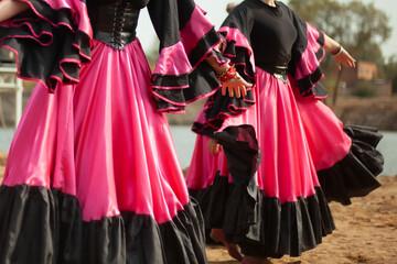 Gypsy dance in black dress. Girl dancing folk dance on the street. Filming of dancing girls from...
