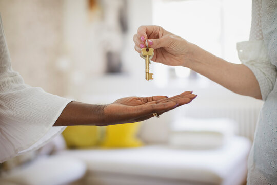 Close up woman receiving house rental keys