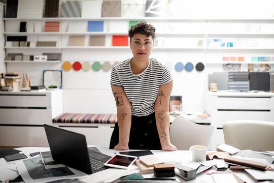 Portrait of designer standing in creative office