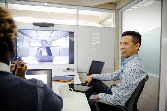 Businesspeople on video conferencing call in office