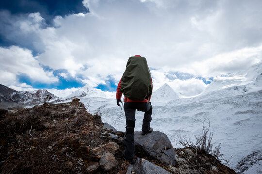 Woman hiker hiking enjoy the view on winter mountain top