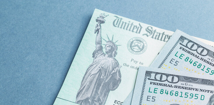 A US stimulus check on with some one-hundred-dollar bills
