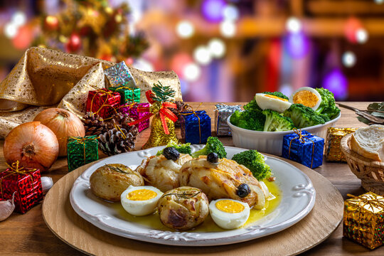 Cod loin baked in olive oil, with potatoes, broccoli, boiled egg and black olives. Typical dish of Portugal. Christmas decoration