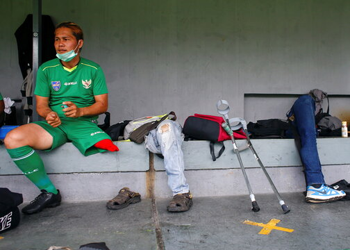 A player from Garuda Indonesia Amputee Football (Garuda INAF) sits beside prosthetic legs as the team commemorates the international disability day in Jakarta
