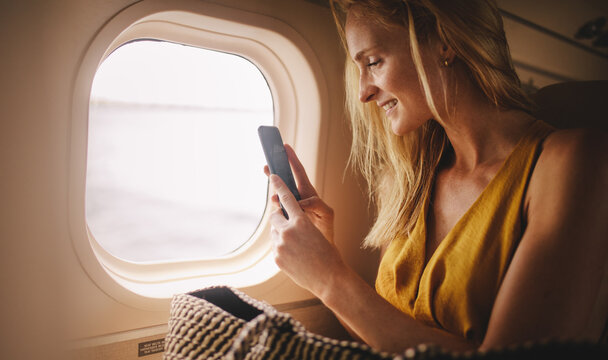 Woman enjoying the view from luxury airplane