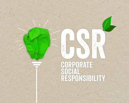 Green paper light bulb metaphor for recycling and acronym CSR - corporate social responsibility renewable energy green climate concept on brown recycled paper