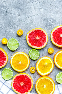 sliced citrus on stone table background top view mock up