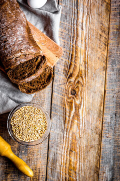 bakery concept with homemade bread on rustic background top view moke-up