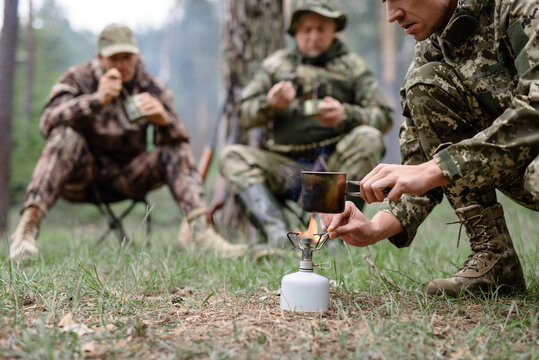 Water Boiling on Hiking Cooker Hunters Camp Fire.