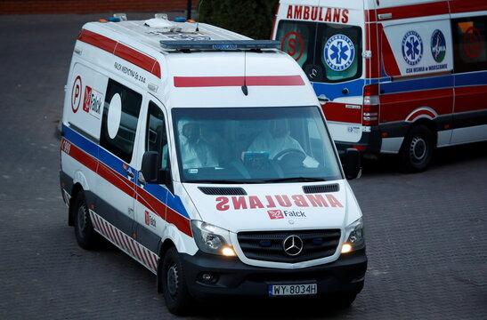 Paramedics drive an ambulance amid the coronavirus disease (COVID-19) outbreak, near a hospital in Warsaw