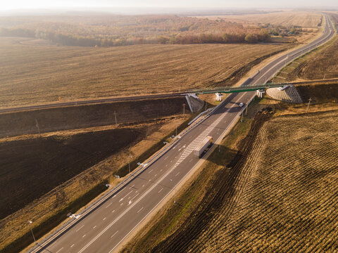 Aerial Top View of highway intersection junction summer morning with car