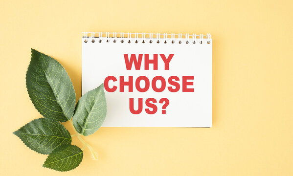 Why choose us text on paper on yellow background