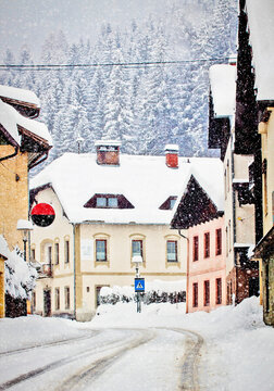 Snow storm covers of white the Austrian Alpine route crossing Koetschach-Mauthen village in Carinthia region, quite a white Christmas vintage postcard