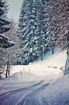 Austrian Alpine route on winter time during snowfall like in a vintage Christmas poscard