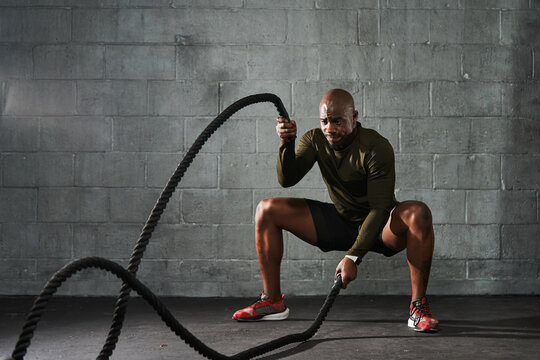 Man doing battle rope training exercises