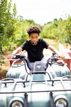 Preteen boy riding offroad ATV 4-wheeler
